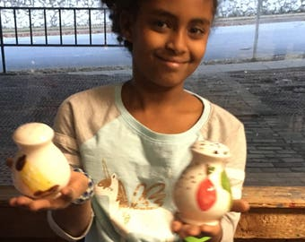 Lyla's salt and pepper shakers for the Tarrant Area Food Bank