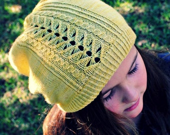 Pollinator slouch beanie featuring a Bee inspired lace panel.