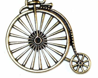 1 large old velocypede charm bronze 53x46mm MB173