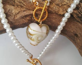 Beautiful delicate Pearl necklace and bracelet set