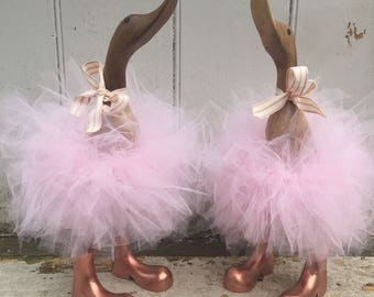 Powder pink tutu duck, with rose gold boots and matching pink ribbon.