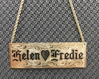 Gold filled nameplate necklace with personalized name.