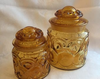 Set of two vintage glass storage canisters