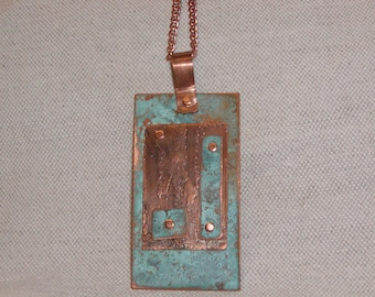 Turquoise blue patina and etched copper riveted necklace