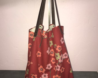 Flowers and red tote bag