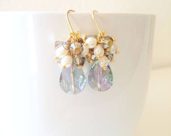 Drop earrings with a crystals and natural pearls