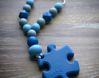 Blue Puzzle Piece Carrier Teether