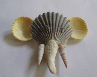Shell elephants, each unique, several styles
