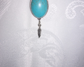 """Turquoise pendant with a small dangling feather on a 24.5"""" silver chain."""