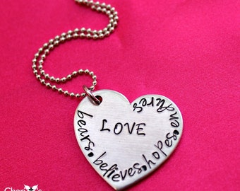 Love bears all things hand stamped scripture necklace
