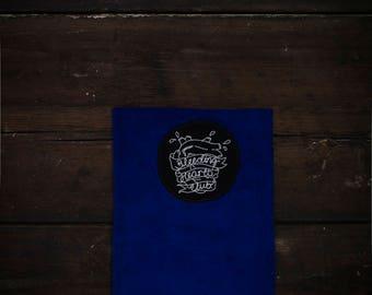Handmade suede tablet sleeve.
