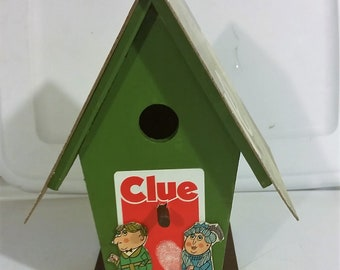Upcycled vintage Clue board game into bird house / feeder