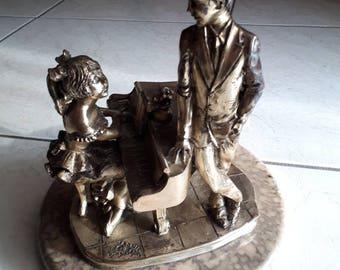 Vintage statue Iron/bronze base marble signed L. Sagni.