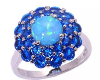 This Ring is Blue Opal encircled by Sapphires set in a Sterling Silver Setting  - size 7