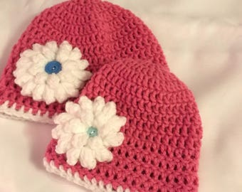 Crochet beanies with crochet flower and button embellishment