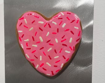 Pink Heart Donut on Brushed Aluminum