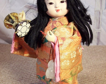 Japanese Tourist Doll