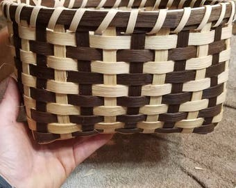 Two toned (brown and natural)hand woven basket