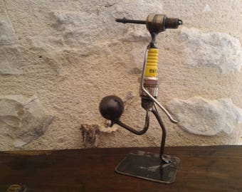 Sculpture candle and recycled parts - football