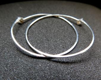 hammered sterling silver hoop earrings. round silver hoops. splurge jewelry.