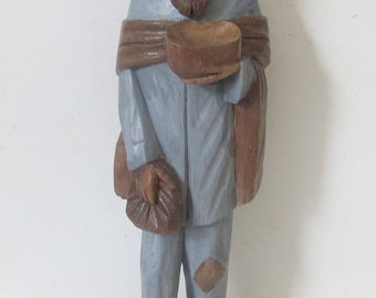 """A 12"""" tall Pilgrim Carrying a Bowl. Two-tone grey & brown wooden folk sculpture from South America hand carved and painted"""
