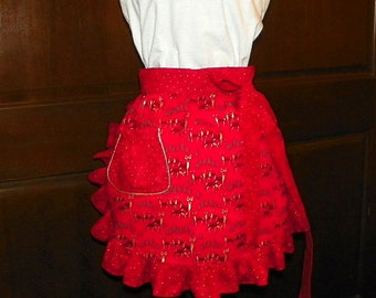 This apron is a Fun Flirty and Sassy Hostess 16 In Red Waist Apron with Gold Deer and Gold Dots