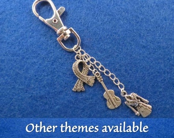 Sherlock bag charm with the theme of your choice.