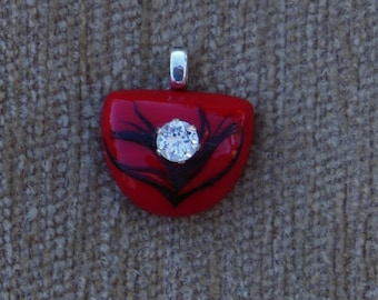 Red cabochon with black feather and genuine white topaz pendant with sterling silver chain