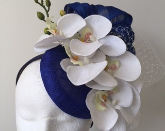 New Cobalt blue fascinator with silk abaca loops and cream flowers on a headband.