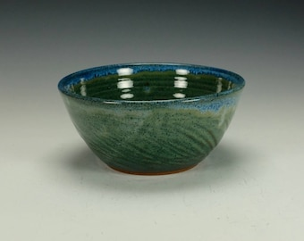 Stoneware pottery bowl.  Blue green with blue streaks.  Ready to ship.