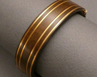 Gutta Percha with gold inlay bracelet
