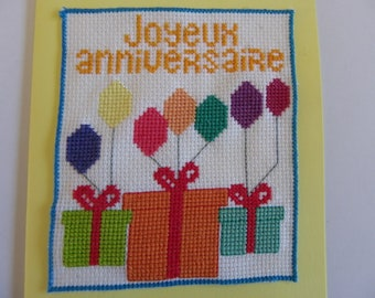 card double yellow embroidered with an envelope for kids birthday, man and woman