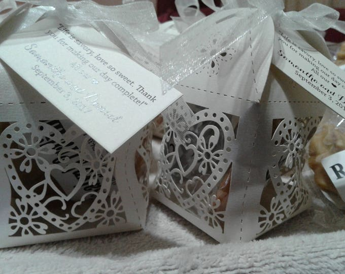 Featured listing image: Elegant Wedding Favors.  Taste of New Orleans Heart Box Favors Tied with Perfect Delight.  Your Guests Will Want More.  A Delicious Memory!
