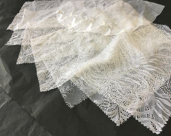 assortment of various smaller sheer lingerie tulle lace / mesh swatches — snow white (floral/embroidery)  — different sizes and patterns