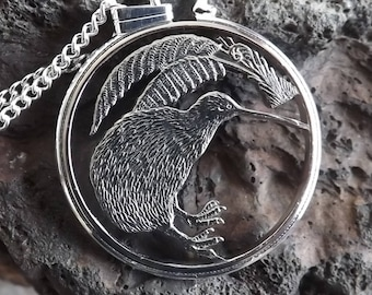 Coin jewellery, hand-cut New Zealand 20 cent coin showing Kiwi bird and vegetation; one of world's most recognisable birds