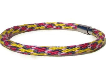 Yellow and pink spot pattern kumihimo bracelet with stainless steel magnetic clasp