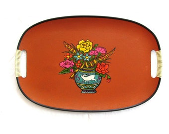 mid century tray painted orange with floral center design and viny wrapped cut out handles