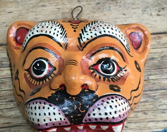 A handmade papier mache tiger mask from India