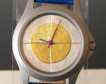 Watch with 24 karat gold and argentium silver