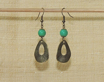Earrings with green jade beads and bronze connector