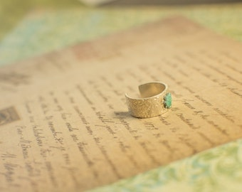 Textured Sterling Silver Ring With Blue Rivet Accent