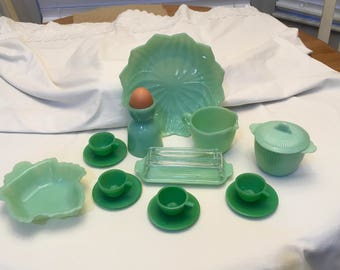 Misc jadite kitchen ware including a very rare butter dish and a maple leaf candy dish