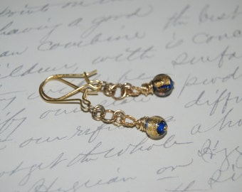 Wire Wrapped Plated Gold  Dangled Earrings with Golden Blue Lampwork Glass.