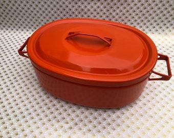 Orange enamel casserole dish