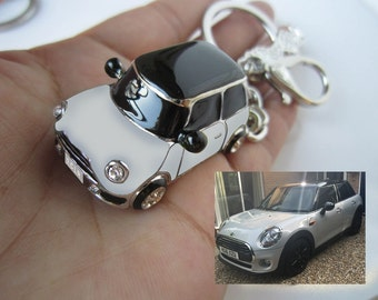 For charlotte white gold Keychain , black of roof and mirrors, not stripes on the bonnet.Sculpture 1 CLR , luxury car keychain