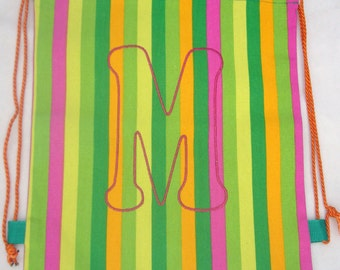 Green striped canvas gym bag with embroidered M initial