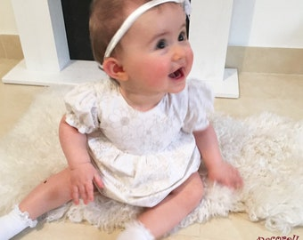 Baby girl summer dress in white with beige flowers and short sleeves