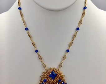 Blue Jingle - Vintage rhinestone clip-on earring converted to a pendant on gold-fill chain with Swarovski crystals