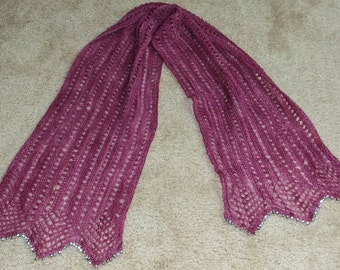 Hand-knit lace scarf with beaded fringe.