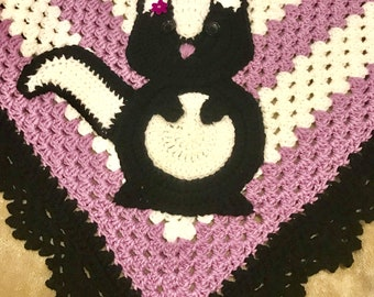 Adorable hand crocheted baby skunk Afghan in lavendar and white.